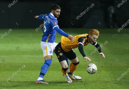 Ryan Haynes of Newport County and Alireza Jahanbakhsh of Brighton compete for the ball