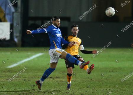 Josh Sheehan of Newport County is challenged by Alireza Jahanbakhsh of Brighton
