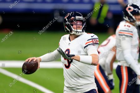 Chicago Bears quarterback Nick Foles (9) warms up before an NFL wild-card playoff football game against the New Orleans Saints in New Orleans