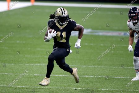 New Orleans Saints running back Alvin Kamara (41) carries in the second half of an NFL wild-card playoff football game against the Chicago Bears in New Orleans