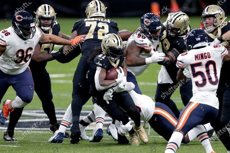 New Orleans Saints running back Alvin Kamara (41) carries in the first half of an NFL wild-card playoff football game against the Chicago Bears in New Orleans