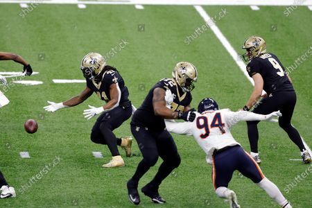New Orleans Saints running back Alvin Kamara (41) drops the ball during an NFL wild-card playoff football game against the Chicago Bears, in New Orleans. The Saints defeated the Bears 21-9