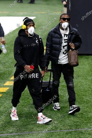 Chicago Bears free safety Eddie Jackson (39) and Chicago Bears cornerback Kindle Vildor (22) walk on the field before an NFL wild-card playoff football game against the New Orleans Saints, in New Orleans. The Saints defeated the Bears 21-9