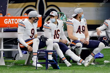 Chicago Bears quarterback Nick Foles (9), punter Pat O'Donnell (16), and long snapper Patrick Scales (48) during an NFL wild-card playoff football game against the New Orleans Saints, in New Orleans. The Saints defeated the Bears 21-9