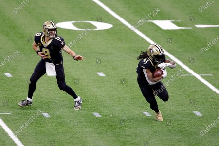 New Orleans Saints quarterback Drew Brees (9) hands the ball to New Orleans Saints running back Alvin Kamara (41) during an NFL wild-card playoff football game against the Chicago Bears, in New Orleans. The Saints defeated the Bears 21-9
