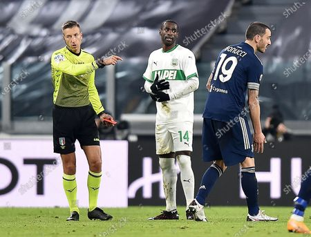 Referee Davide Massa shows the red card tp Sassuolo's Pedro Obiang (C) during the Italian Serie A soccer match Juventus FC vs US Sassuolo Calcio at the Allianz Stadium in Turin, Italy, 10 January 2021.