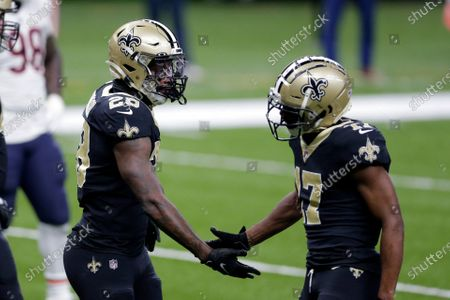 New Orleans Saints running back Latavius Murray (28) is congratulated by wide receiver Emmanuel Sanders (17) after his touchdown reception in the second half of an NFL wild-card playoff football game against the Chicago Bears in New Orleans