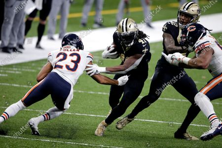 New Orleans Saints running back Alvin Kamara (41) carries against Chicago Bears cornerback Kyle Fuller (23) in the second half of an NFL wild-card playoff football game in New Orleans