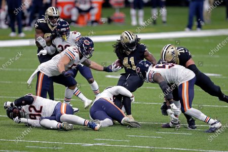 New Orleans Saints running back Alvin Kamara (41) carries for a first down in the first half of an NFL wild-card playoff football game against the Chicago Bears in New Orleans
