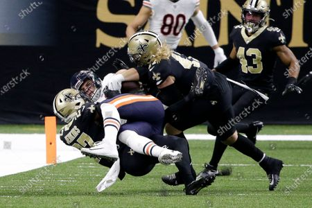 Chicago Bears tight end Cole Kmet is tackled on a reception by New Orleans Saints strong safety Malcolm Jenkins (27) and middle linebacker Alex Anzalone in the first half of an NFL wild-card playoff football game in New Orleans