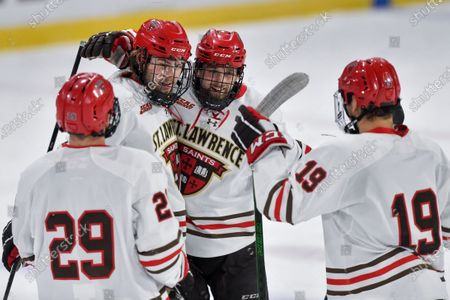 St. Lawrence defenseman Philip Alftberg, second from right, celebrates with forward Jordan Steinmetz (29), forward Justin Paul (14) and forward Max Dorrington (19) after scoring a goal against Colgate during the second period of an NCAA hockey game on in Canton, N.Y