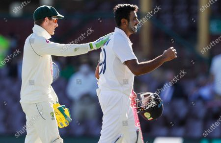 Australian captain Tim Paine, left, congratulates not out batsman India's Ravichandran Ashwin following play on the final day of the third cricket test between India and Australia at the Sydney Cricket Ground, Sydney, Australia, . The test ended in a draw and the series is at 1-1 all with one test to play