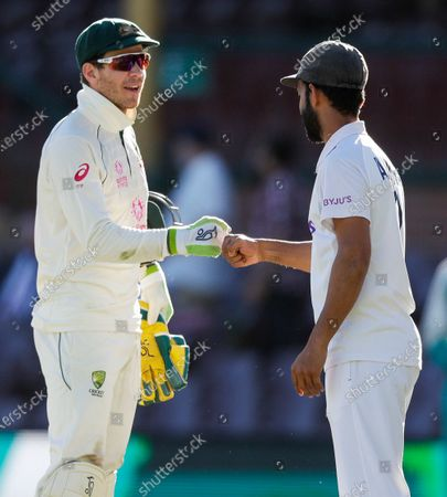 Stock Photo of Rival captain's Australia's Tim Paine, left, and India's Ajinkya Rahane gesture to each other following play on the final day of the third cricket test between India and Australia at the Sydney Cricket Ground, Sydney, Australia, . The test ended in a draw and the series is at 1-1 all with one test to play