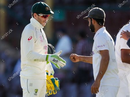 Stock Picture of Rival captain's Australia's Tim Paine, left, and India's Ajinkya Rahane gesture to each other following play on the final day of the third cricket test between India and Australia at the Sydney Cricket Ground, Sydney, Australia, . The test ended in a draw and the series is at 1-1 all with one test to play