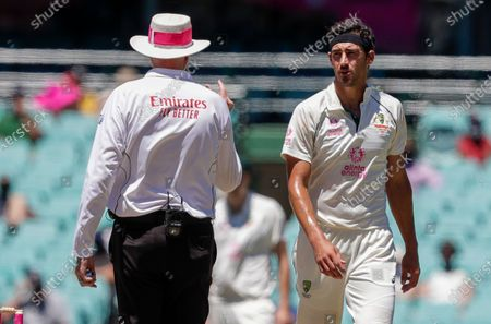 Umpire Paul Wilson, left, gestures to Australian bowler Mitchell Starc during play on the final day of the third cricket test between India and Australia at the Sydney Cricket Ground, Sydney, Australia