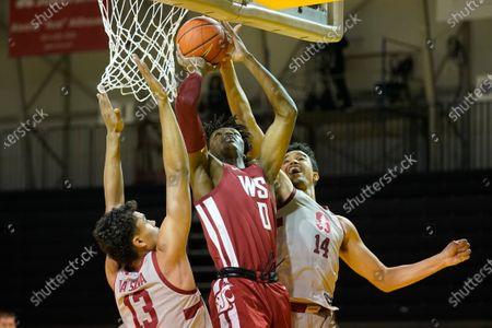 Washington State center Efe Abogidi (0) shoots betwwen Stanford forward Oscar da Silva (13) and forward Spencer Jones (14) during an NCAA college basketball game in Santa Cruz, Calif