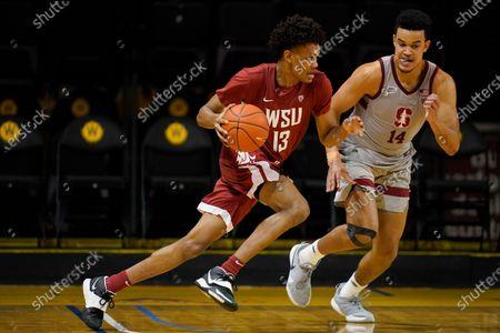 Washington State forward Carlos Rosario (13) drives against Stanford forward Spencer Jones (14) during an NCAA college basketball game in Santa Cruz, Calif