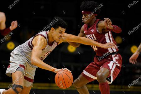 Stanford forward Spencer Jones, left, drives against Washington State guard Noah Williams during an NCAA college basketball game in Santa Cruz, Calif