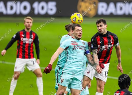 Alessio Romagnoli of AC Milan fights for the ball against Andrea Belotti of Torino FC