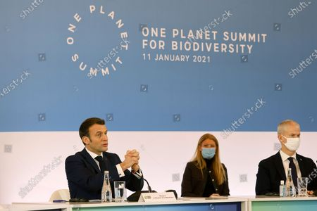 French President Emmanuel Macron (L) speaks next to French Junior Minister of Foreign Trade Franck Riester (R) to close the first roundtable during the 'One Planet Summit' for Biodiversity, which is part of the World Nature Day, at The Elysee Palace in Paris, France, 11 January 2021. Organized in cooperation with the United Nations (UN) and the World Bank, the summit aims at raising the level of ambition of the international community on the protection of nature, while responding to the new questions raised by the crisis.