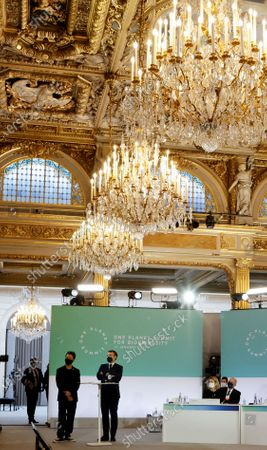 French President Emmanuel Macron (R), flanked by French singer Christophe Mae (L), speaks during the One Planet Summit, part of World Nature Day, at the Reception Room of the Elysee Palace, in Paris, France, 11 January 2021. The One Planet Summit, a largely virtual event hosted by France in partnership with the United Nations and the World Bank, will include French President, German Chancellor and European Union chief.