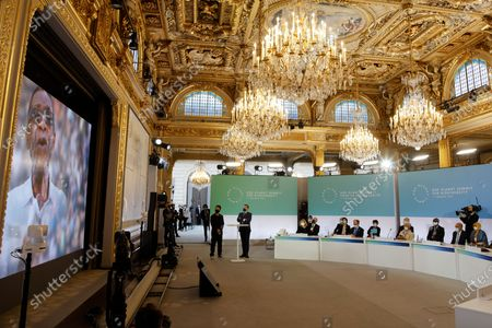 Stock Picture of French President Emmanuel Macron (2ndL), flanked by French singer Christophe Mae (L), looks at Senegalese singer Youssou N'Dour speaking on a screen, during the One Planet Summit, part of World Nature Day, at the Reception Room of the Elysee Palace, in Paris, France, 11 January 2021. The One Planet Summit, a largely virtual event hosted by France in partnership with the United Nations and the World Bank, will include French President, German Chancellor and European Union chief.