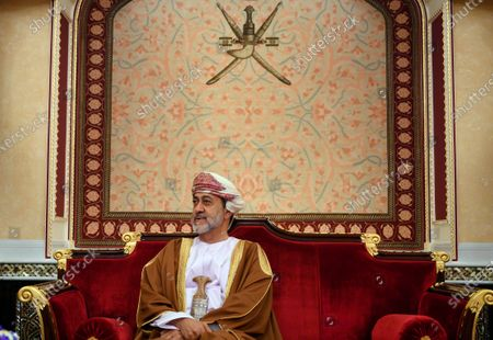 Oman's ruler Sultan Haitham bin Tariq prepares for a meeting at al-Alam palace in the capital Muscat, Oman. The sultan announced, a shake-up of the country's constitution with changes that include the appointment of a crown prince for the first time and steps to boost government transparency. The move, one year after the death of Sultan Qaboos bin Said comes as the government faces growing economic pressures at home