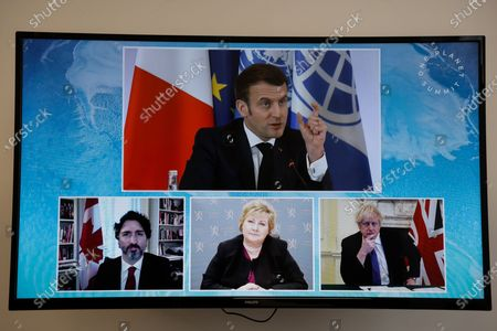 French President Emmanuel Macron (up), Canadian Prime Minister Justin Trudeau (L), Norwegian Prime Minister Erna Solberg (C) and Britain's Prime Minister Boris Johnson (R) attend a video conference meeting during the One Planet Summit, part of World Nature Day, at the Reception Room of the Elysee Palace, in Paris, France, 11 January 2021. The One Planet Summit, a largely virtual event hosted by France in partnership with the United Nations and the World Bank, will include French President, German Chancellor and European Union chief.