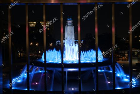 LOS ANGELES, CA - JANUARY 08, 2021 - Los Angeles' City Hall is lit in Dodger blue tonight and through the weekend to honor the loss of former Los Angeles City Councilmember Tom LaBonge and Dodgers legend Tommy Lasorda as seen from Jerry Moss Plaza in Los Angeles on January 8, 2021. The blue cast on City Hall was requested by City Council President Nury Martinez and Mayor Eric Garcetti, according to Martinez' office. (Genaro Molina / Los Angeles Times)