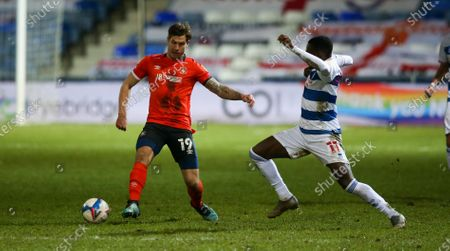 Bright Osayi-Samuel of QPR tackles James Collins of Luton Town