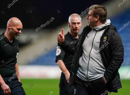 Stock Picture of Karl Robinson Oxford United Manager exchanges words with Referee Charles Breakspear at half-time