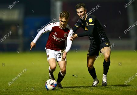 Danny Rose  of Northampton Town    competes for the ball with Daniel Harvie of Milton Keynes Dons