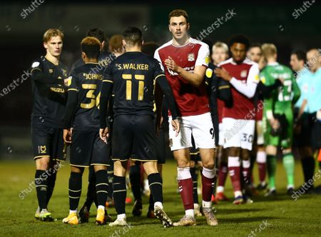 Harry Smith of Northampton Town  shakes hands with Stephen Walker of Milton Keynes Dons after the match