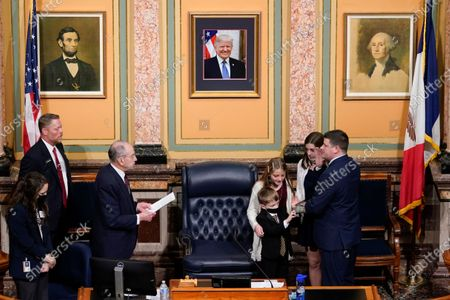 Sen. Charles Grassley, R-Iowa, left, administers the oath of office to his grandson, Iowa House Speaker Pat Grassley, right, on the opening day of the Iowa Legislature, at the Statehouse in Des Moines, Iowa