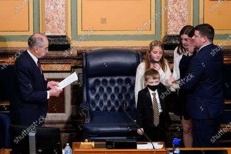Stock Image of Sen. Charles Grassley, R-Iowa, left, administers the oath of office to his grandson, Iowa House Speaker Pat Grassley, right, on the opening day of the Iowa Legislature, at the Statehouse in Des Moines, Iowa