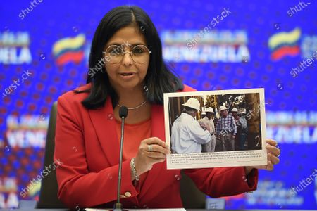 Stock Image of Venezuelan Vice President Delcy Rodriguez holds up a photo with a caption that says former Guayana President David Arthur Granger stands on the Deepwater Champion drillship and demands Exxon stop drilling in a disputed area, during a press conference at Miraflores presidential palace in Caracas, Venezuela, . Since 2015, Venezuela and Guyana have repeatedly faced friction as a result of oil exploration carried out by a US subsidiary of Exxon Mobil by the decision of the Georgetown government in an area disputed since the 19th century off the north coast of South America