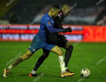 Stock Image of Stockport County's Alex Reid, left, duels for the ball with West Ham's Angelo Ogbonna during the English FA Cup third round soccer match between Stockport County and West Ham United at Edgeley Park in Stockport, England