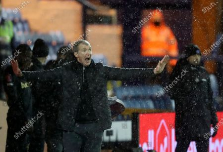 Stockport County's manager Jim Gannon reacts during the English FA Cup third round soccer match between Stockport County and West Ham United at Edgeley Park in Stockport, England