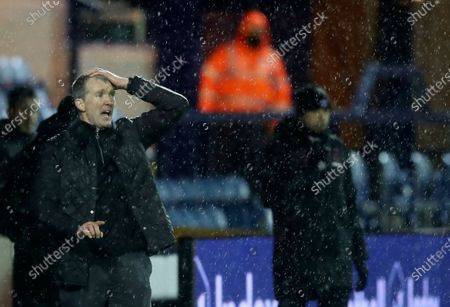 Stock Photo of Stockport County's manager Jim Gannon reacts during the English FA Cup third round soccer match between Stockport County and West Ham United at Edgeley Park in Stockport, England