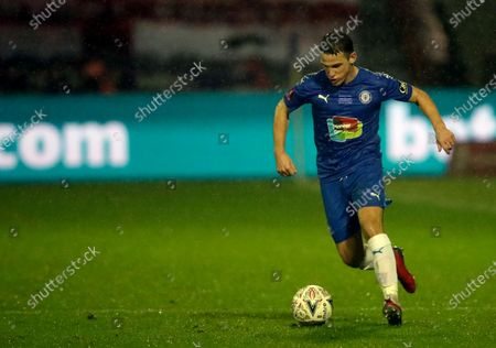 Stock Photo of Stockport County's John Rooney controls the ball during the English FA Cup third round soccer match between Stockport County and West Ham United at Edgeley Park in Stockport, England