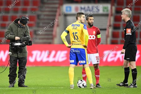 Waasland-Beveren's Dries Wuytens, Standard's Mehdi Carcela and referee Christof Dierick pictured before the start of a soccer match between Standard de Liege and Waasland-Beveren, Monday 11 January 2021 in Liege, an advanced day 30 of the 'Jupiler Pro League' first division of the Belgian championship.