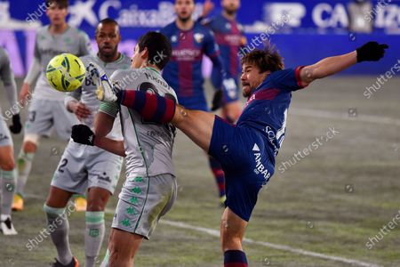 Huesca's forward Shinji Okazaki (R) in action against Aissa Mandi (C) of Betis during the Spanish LaLiga soccer match between SD Huesca and Real Betis at El Alcoraz stadium in Huesca, northern Spain, 11 January 2021.