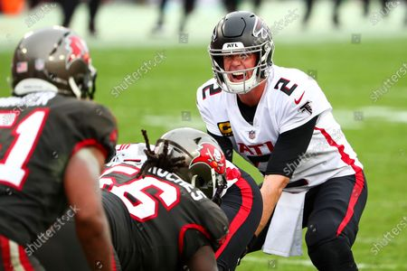 Atlanta Falcons quarterback Matt Ryan (2) lines up behind his offensive line during the second half of an NFL football game against the Tampa Bay Buccaneers, in Tampa, Fla