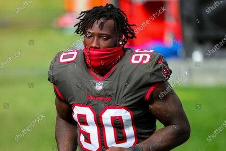 Tampa Bay Buccaneers outside linebacker Jason Pierre-Paul (90) runs to the locker room during halftime of an NFL football game against the, in Tampa, Fla