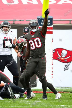 Tampa Bay Buccaneers outside linebacker Jason Pierre-Paul (90) celebrates after a tackle during the first half of an NFL football game against the Atlanta Falcons, in Tampa, Fla