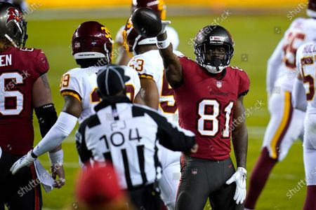 Tampa Bay Buccaneers wide receiver Antonio Brown (81) gestures after catching a pass for a first down against the Washington Football Team during the first half of an NFL wild-card playoff football game, in Landover, Md. Tampa Bay won 31-23