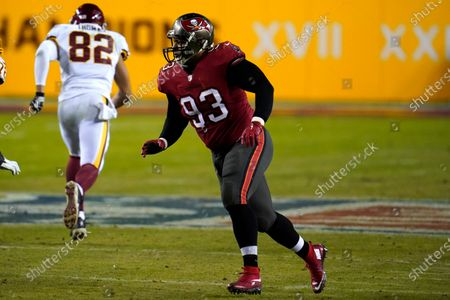 Tampa Bay Buccaneers defensive end Ndamukong Suh rushes in on the Washington Football Team during the second half of an NFL wild-card playoff football game, in Landover, Md. Tampa Bay won 31-23