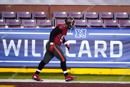 Tampa Bay Buccaneers defensive end Ndamukong Suh takes the field to work out prior to an NFL wild-card playoff football game against the Washington Football Team, in Landover, Md. Tampa Bay won 31-23