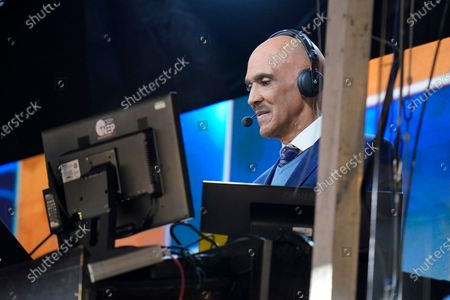 Tony Dungy looks on from the broadcast booth during the first half of an NFL wild-card playoff football game between the Washington Football Team and the Tampa Bay Buccaneers, in Landover, Md. Tampa Bay won 31-23