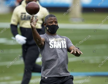 Stock Photo of New Orleans Saints secondary coach Aaron Glenn throws prior to an NFL football game against the Carolina Panthers in Charlotte, N.C. The New York Jets interviewed Tennessee Titans offensive coordinator Arthur Smith and Glenn, for their head coaching vacancy